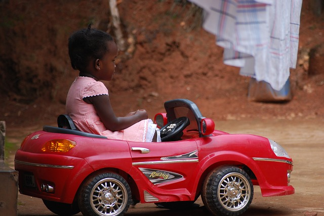 Child in Ride On Car